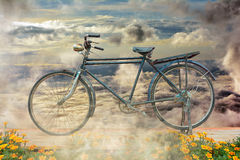 Antique bicycle balcony flowers . Stock Photos