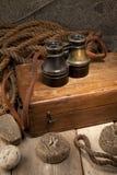 Antique binoculars. On old wooden box Stock Image