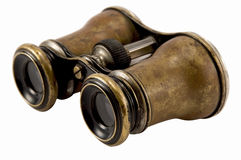Antique binoculars. A pair of antique binoculars isolated on white background royalty free stock photos