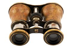 Antique binoculars. A pair of antique binoculars isolated on white background royalty free stock image