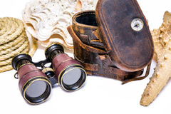 Antique binoculars with leather case , rope and  star fish  isolated on white. Backround Royalty Free Stock Image