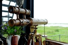Antique binoculars made from brass. stock image