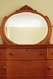Antique bird's eye maple dresser and mirror Royalty Free Stock Photos