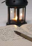 Antique black candlestick, candle and old letter. Close up Stock Photography