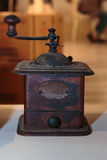 Antique Black Coffee Grinder on White Table.  stock photo