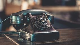 Antique Black Telephone On Wooden Table royalty free stock image