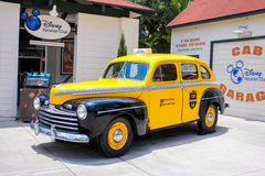 Antique black and yellow cab at WDW Stock Photo