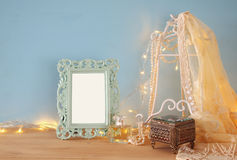 Antique blank victorian style frame on wooden table Royalty Free Stock Photo