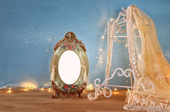 Antique blank victorian style frame on wooden table Stock Images