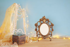 Antique blank victorian style frame on wooden table. ready to put photography. Stock Photography