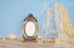Antique blank victorian style frame on wooden table Stock Photo