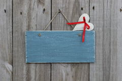 Antique blue sign hanging on wood door with muslin heart Royalty Free Stock Image