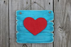 Antique blue sign with large red heart Stock Photography