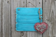 Antique blue sign with plaid and wood hearts Royalty Free Stock Photos