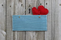 Antique blue sign with red hearts Royalty Free Stock Image