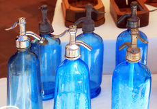 Antique blue soda syphon bottles on flea market Stock Images