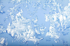 Antique blue and white french baroque pattern wallpaper depicts. Pastoral men and women wine making Stock Images