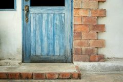 Antique blue wood doors and window with red brick wall stock images