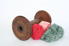 Antique bobbin. And wool Royalty Free Stock Photos