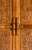 Antique bolt on wooden flowered door Royalty Free Stock Photos