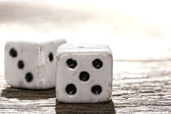 Antique Bone Craps and Wager Shooting Dice on Wood Royalty Free Stock Photos