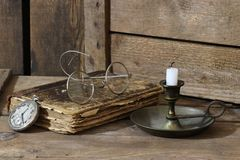 Antique book. With accessories on wooden background royalty free stock photography
