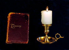 Antique book and candle Royalty Free Stock Photography