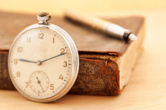 Antique book and clock Stock Photo