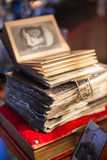 Antique book in dim light. Antiques in dim light. Old antique book Royalty Free Stock Photos
