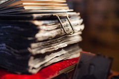 Antique book in dim light. Antiques in dim light. Old antique book Royalty Free Stock Photo