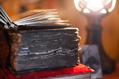 Antique book in dim light. Antiques in dim light. Old antique book Royalty Free Stock Images