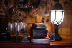 Antique book in dim light Stock Images