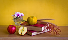 Antique book with flower and fruit Stock Photos