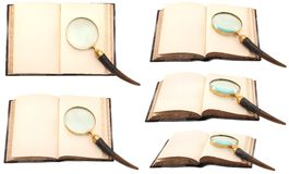 Antique book with a magnifying glass. Antique opened book with an antique-style magnifying glass (set from different angles) isolated on white background Royalty Free Stock Images