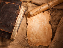 Antique book and old papers. On burlap Stock Photo