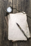 Antique book and old pocket watch Stock Photography