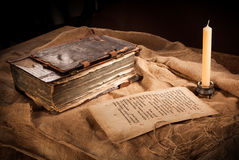 Antique book, paper and candle Royalty Free Stock Photos