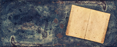 Antique book on rustic metal texture background Stock Photo