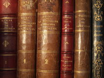Antique books. Close-up of a row of old books from the 18th and 19th century. Gilt-edged titles. Leather bindings stock photos