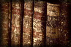 Antique books. Antique vintage old retro worn grunge brown books in row on bookshelf Royalty Free Stock Photography