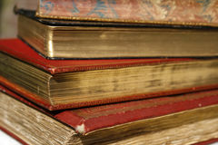 Antique books. Vintage books with special golden coating on pages Stock Photos
