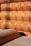 Antique Books. Close up of some antique books, one open showing pages Royalty Free Stock Photo