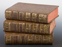 Antique books. Pile of antique books on graduated grey background Royalty Free Stock Photos