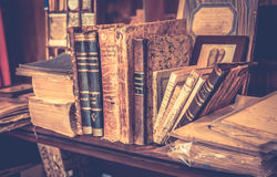 Antique books in antiquarian bookshop. MONTEPULCIANO, ITALY - JUNE 23, 2015: collection of antique books and maps in tuscan antiquarian bookshop in Montepulciano Stock Photo