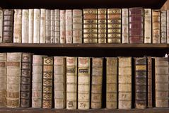 Antique Books on Bookshelf Stock Image