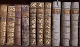 Antique Books on Bookshelf Royalty Free Stock Photos