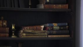 Antique books on bookshelf motion.  stock video footage