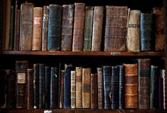 Antique books on bookshelf. Shelf with old books. Library Stock Image