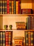 Antique books, boxes and candlesticks stock photos
