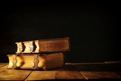 Antique books, with brass clasps. fantasy medieval period and religious concept Stock Photo